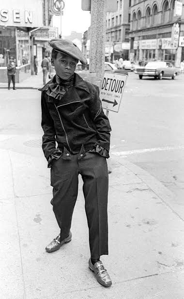 Boy in 1960's Harlem by street photographer Robert Frank  This singular photograph shows real character and spirit within this boy. It looks like a posed photograph but i know street photography never is so that just goes to show how amazingly timed this photo was.
