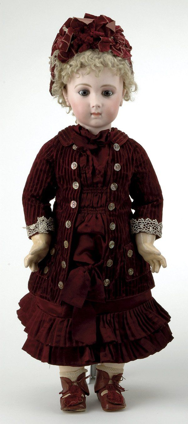 "France, ca 1880, pressed bisque socket head incised 13, blue glass eyes, finely painted brows and lashes, closed mouth, applied pierced ears, original blonde mohair wig with cork pate, marked Jumeau body, wearing original burgundy silk and velvet dress with matching hat, 28"" t."
