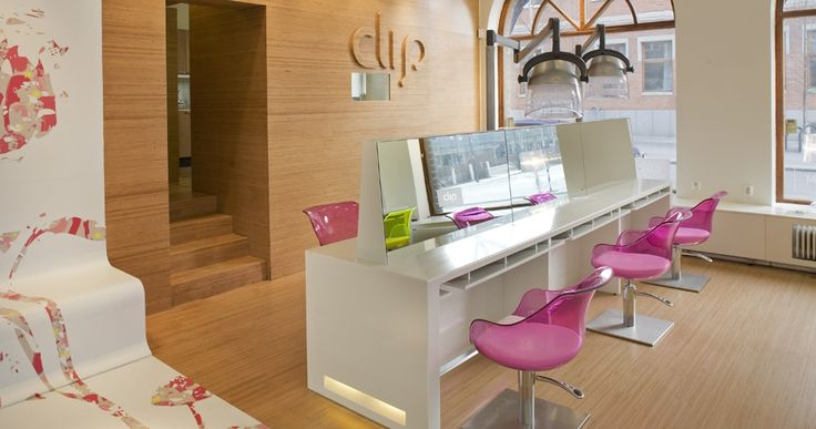 Plexwood Clip hair salon design with bright neon yellow chairs and funky details, plywood wall display and plywood flooring // Sweco