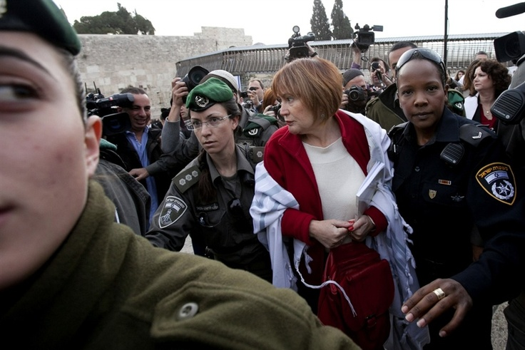 A woman is arrested for wearing a prayer shawl at the Western Wall on April 11, 2013.