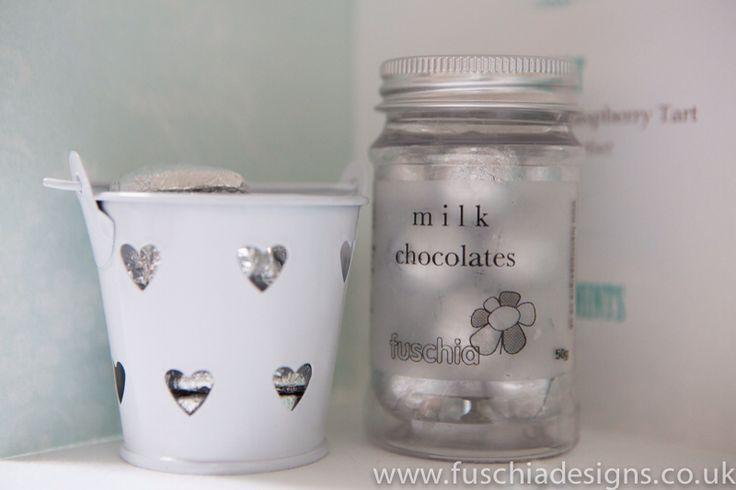 Wedding favours cute milk chocolate wedding favour candy jars. www.fuschiadesigns.co.uk