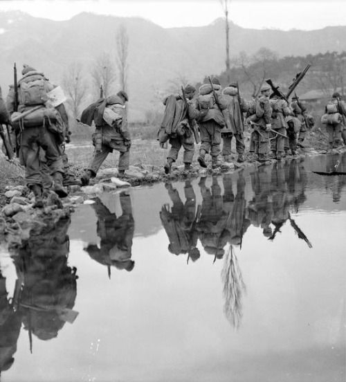 Korean war; A company of the Princes Patricia's Canadian Light Infantry moves in single file across rice paddies as it advances on enemy positions across the valley, March 1951.