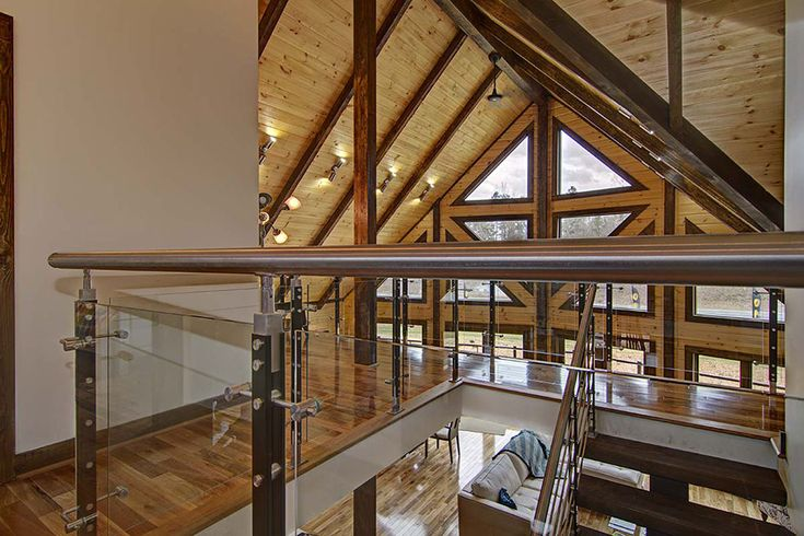 This Timber Block home is beautifully designed, and creates a warm feel, thanks to the wonderful blend of wood stain colors, floor, a bit of drywall and modern railings. www,timberblock.com