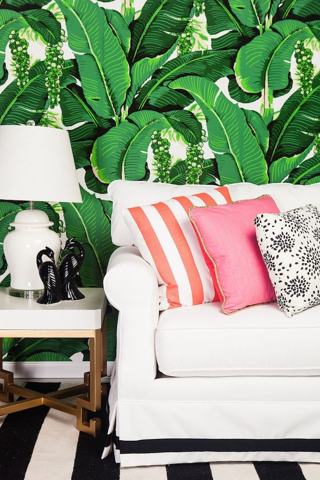Liven up your living room with a tropical-leaf-inspired statement wall.