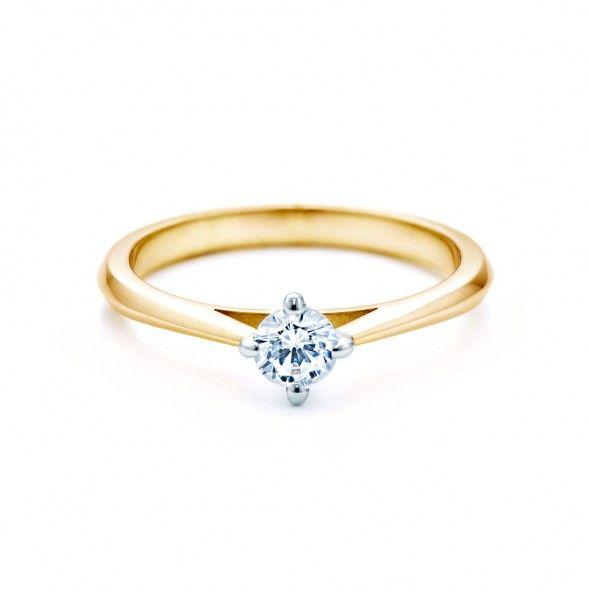 Pierścionek zaręczynowy z diamentem 0,20 ct o szlifie brylantowym wysokiej czystości SI1/G, wykonany z 18-karatowego żółto-białego złota (próba 0,750). www.savicki.pl/kolekcje/the-light-pl