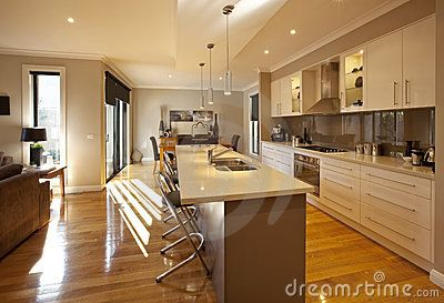 Modern open-plan kitchen, dining and living area, with granite benchtops and polished floorboards.
