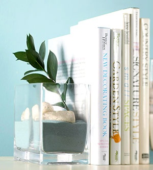 Make bookends using glass vases filled with colored floral decor sand, aquarium gravel, shells, sea glass or polished stones.