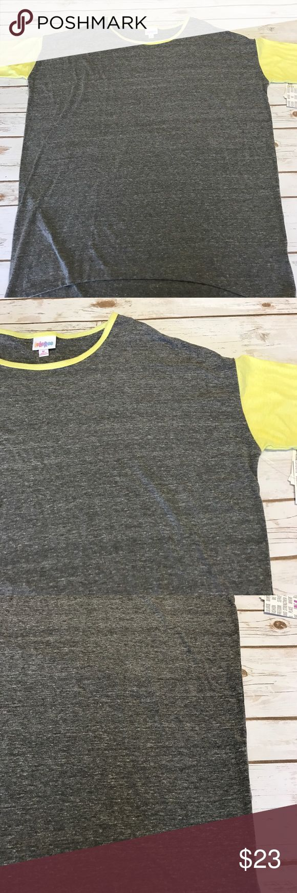 "Brand New LuLaRoe Irma M Brand New LuLaRoe Irma size M. 27"" across under the arms. 35"" length from the tip of shoulder to the bottom of the back hem. The yellow fabric on the collar of this shirt is thin and only one layer over the bias trim on the grey body. Therefore it casts a shadow under the yellow and to me makes the collar in certain lights appear almost like it might be dirty because the grey shows through the yellow. But the shirt is not dirt or stained. It is brand new. It is only…"