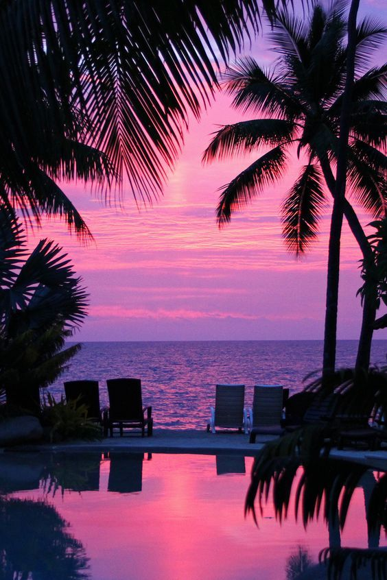 Sunset in Hawaii ~ This looks like the deck and pool outside of Duke's next to the Moana: