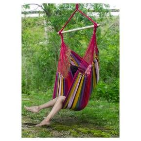 Indoor and Outdoor Relaxation in Style! You'll be swinging in style from almost any location you desire with our colorful Brazilian Hammock Chair. It's perfect for lounging & provides a cozy setting for a morning of reflection or an afternoon of unwinding. Some people like to put this Hammock Chair on their front porch in the spring, and then move it into the house during the winter- in front of the fireplace for a quiet respite on a cold evening. Or, some prefer the quiet bedroom...