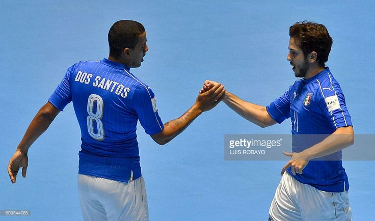 Italy's Murilo Ferreira (R) celebrates with his teammate Sergio Romano his goal against Egypt during their Colombia 2016 FIFA Futsal World Cup match, at the Coliseo El Pueblo stadium, in Cali, Colombia on September 22, 2016. / AFP / LUIS