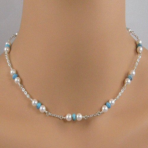 This pretty necklace is made with 6mm turquoise rondelles that are surrounded by 6mm white Swarovski simulated pearls and wire wrapped onto sterling silver chain. The necklace is approximately 17 inch