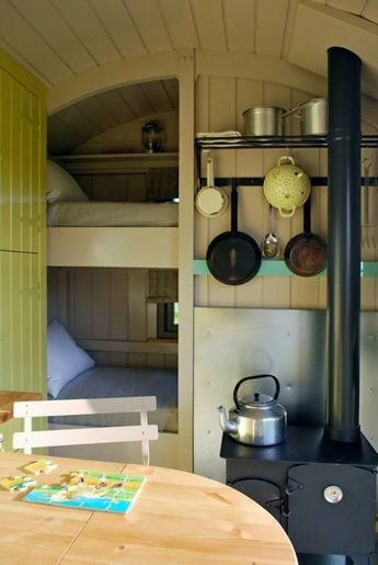 Wriggly Tin Shepherd's Huts.  The double doors really let the outside in and make the hut feel incredibly spacious. The hut is fully equipped for up to five people.  http://tinyhouseblog.com/vardo/wriggly-tin-shepherds-huts/