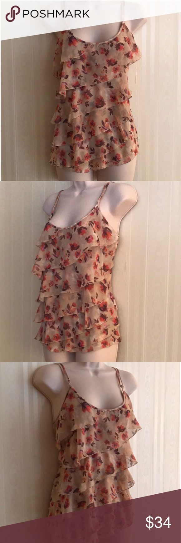 LAUREN CONRAD tiered cami top NEVER WORN Beautiful pink and brown cami top with tiered front.  Very slimming.  Adjustable straps.  Soft and silky.  Never worn, but has been washed.  In excellent condition. LC Lauren Conrad Tops Camisoles