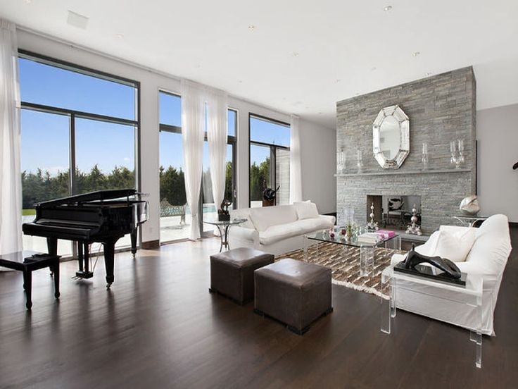 Living Room In The Hamptons With A Grand Piano Wood Floor Length Glass Windows And Door White Couches Lucite Coffee Table Accent Tables