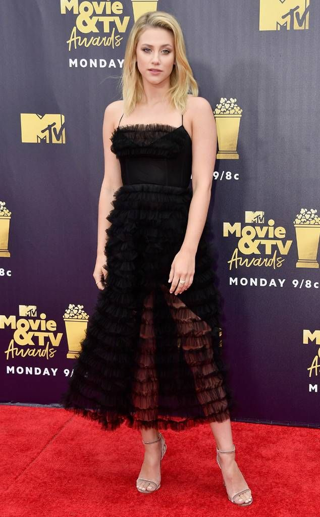 51863d2512 Lili Reinhart from MTV Movie   TV Awards 2018  Red Carpet Fashion The  Riverdale actress looks romantic in this little black dress by IZETA.