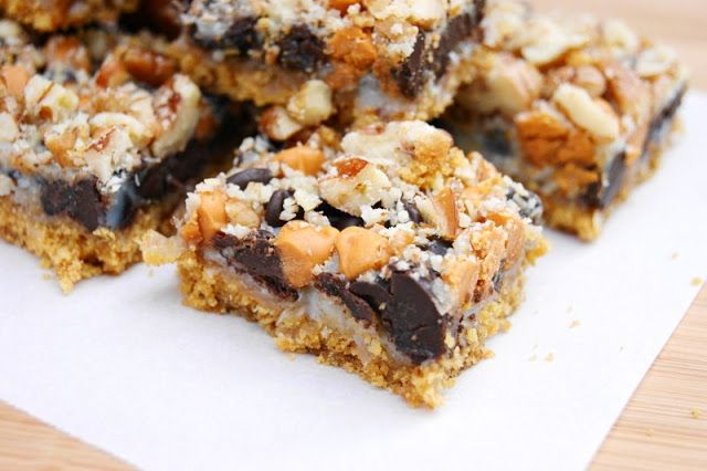 7 Layer Cookies ... you can't go wrong with 7 yummy ingredients layered together in a pan! www.thekitchenismyplayground.com  #magicbars