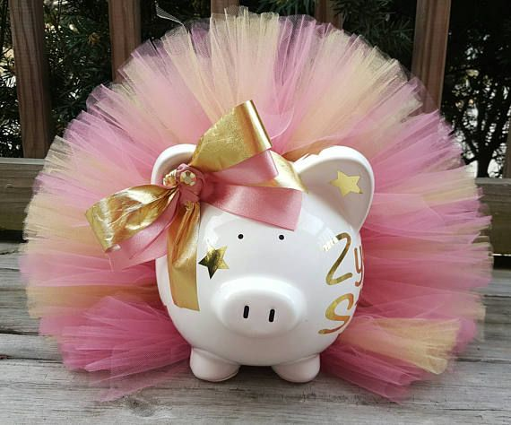 Pink and Gold Tutu Piggy Bank. Perfect for a gift or room decor. This piggy bank features personalization along with stars. Stars can be left off if requested. Leave name in note to seller section during checkout Colors can be changed upon request. Item is handmade in a pet free