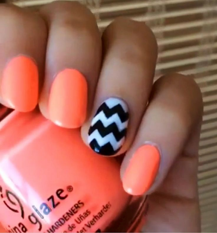 Neon orange nails with a chevron ring finger nail. Thumb is orange. So cute!