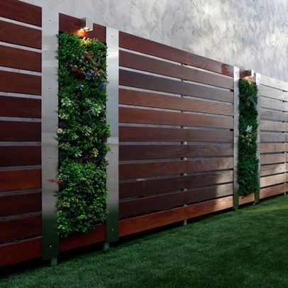 LOVE, LOVE, LOVE this fencing. The stainless on the side of the vertical garden really sets it off. vertical succulent garden on a modern wood fence