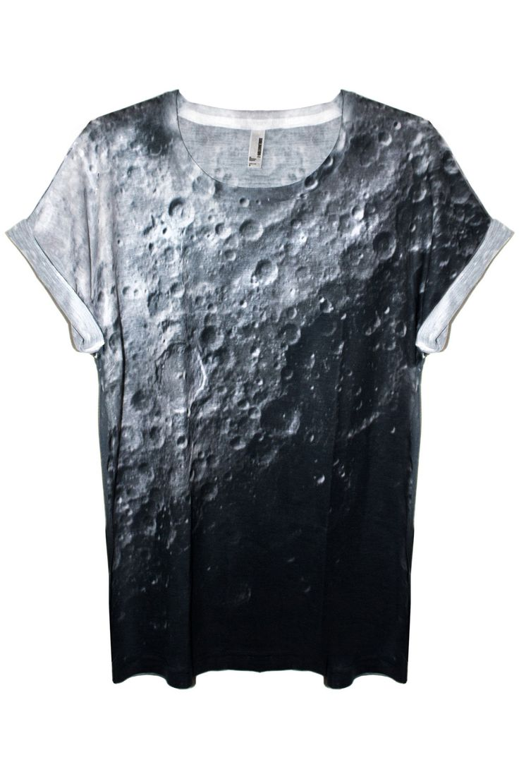 Unisex Moon Print Tee Shirt 100% Polyester tee shirt featuring a really awesome image of the Moon's surface. Relaxed fit, soft material. Model wears Small. International Shipping Available. Please not