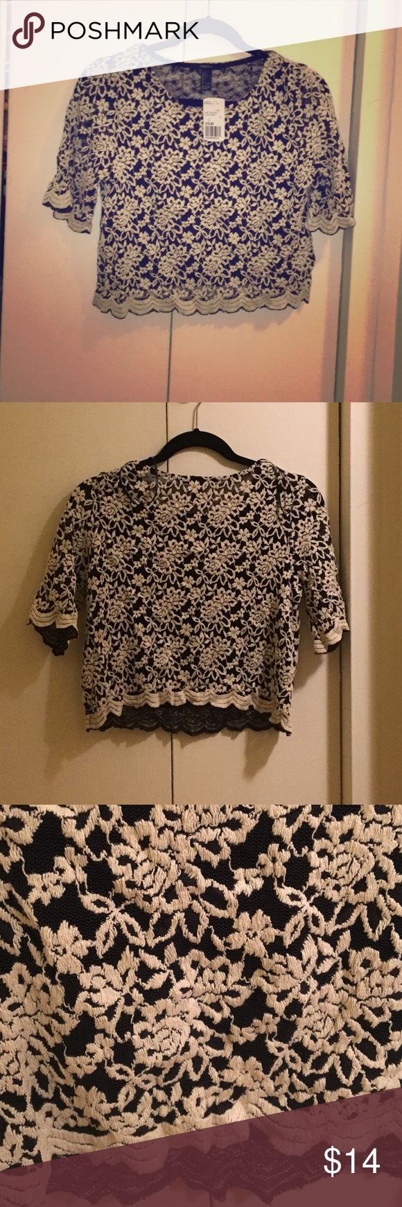 Lacey floral crop top Gorgeous black and cream crop top, brand new with tags on. Floral lace pattern goes great with everything ! Forever 21 Tops Crop Tops