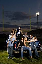 Okay I admit I was a bit apprehensive at first, but Friday Night Lights is more than a football show. It is more than just some regular old tv drama. The characters are complex, interesting, and easy to relate to. I swear it will take you right back into high school or what we all wish high school football was really like. Just watch a couple episodes and it will be promising.