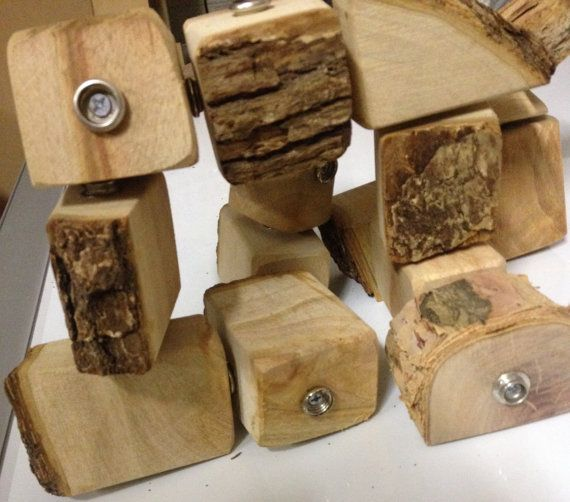 Handmade Wooden Stud Blocks $28.00..All our items are handcrafted and made out of tree branches. Australia Made. Please note our products are a natural wood. You may find some saw dust residue on them, the bark may flake or peel off somewhat and the surface may crack lightly as it dries out. None of this will affect their intended purpose and is a completely natural characteristic of fresh cut wood products.