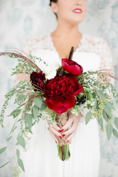 Red garden roses with a pop of white bouquet