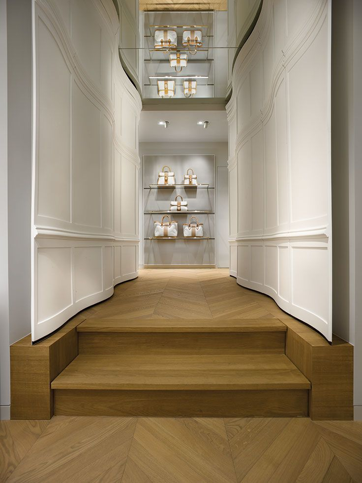 panelling | retail design | Carved corridor in the Delvaux boutique at the Galerie de la Reine