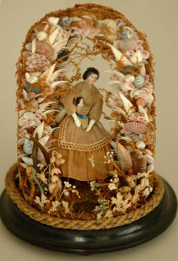 love...china dolls with shell and seaweed surround...displayed in glass dome.
