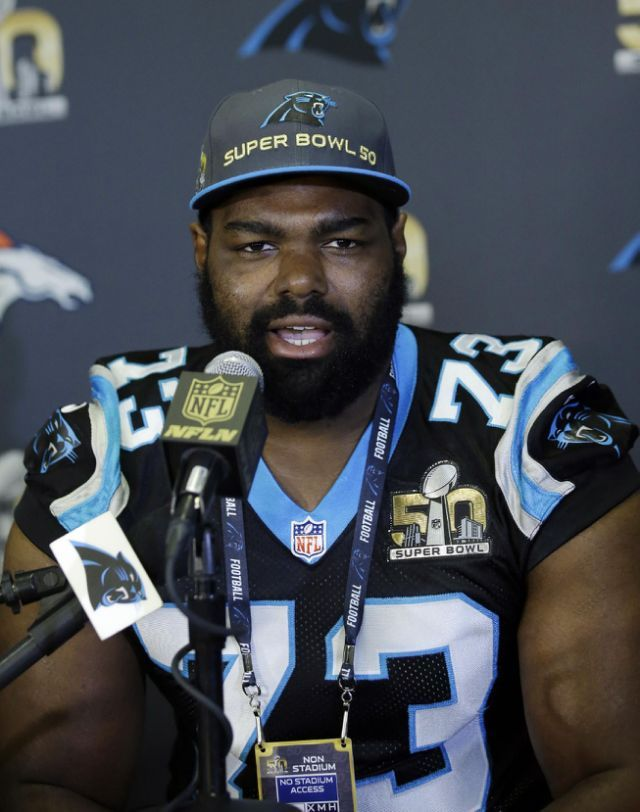Carolina Panthers tackle Michael Oher has signed an extension and yet still gets Blind Side jokes from teammates. (AP Photo/Marcio Jose Sanchez)