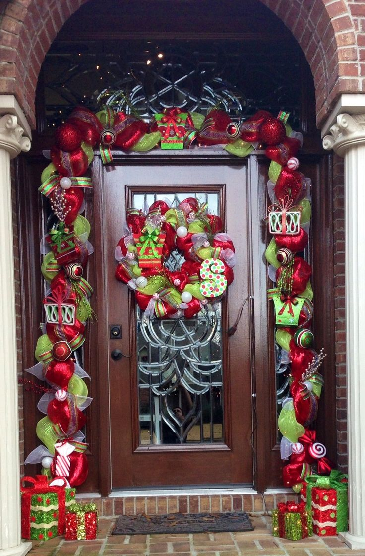Deco mesh garland around front door christmas for Door garland christmas