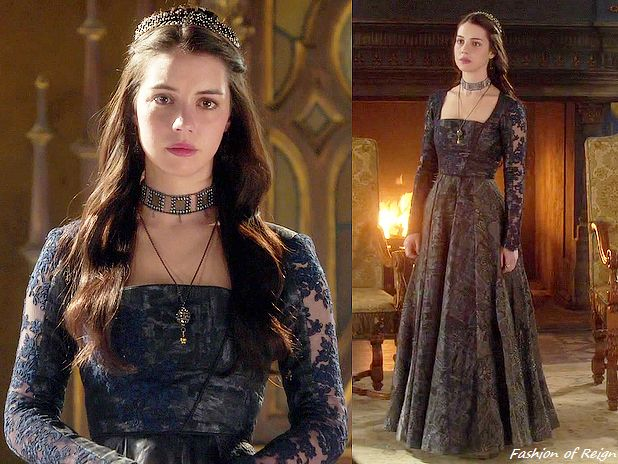 "In episodes 2x06 (""Three Queens"") and 2x22 (""Burn"") Queen Mary wears this stunning Reign Costumes custom dress with navy blue lace inserts.In the sixth episode she wears this dress with a ManiaMania necklace, Gillian Steinhardt labyrinth and signet rings as is in the finale together with this Paris by Debra Moreland tiara and Isabel Marant earrings."