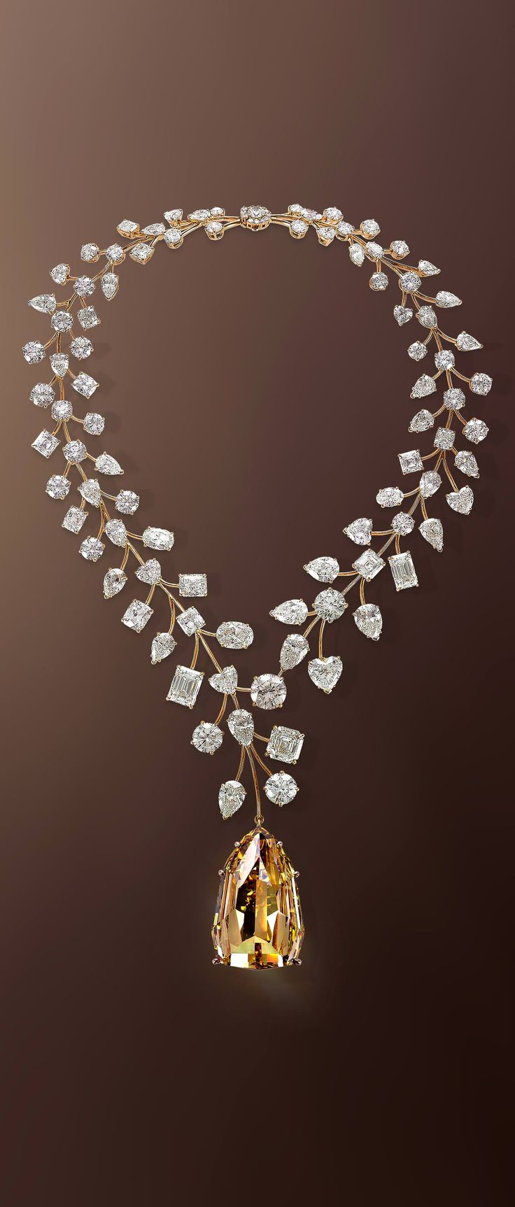 The Mouawad L'Incomparable Diamond Necklace Features the Flawless 407.48-Carat Yellow Diamond, Suspended from a White Diamond Necklace Intertwined by 18-Karat Rose Gold Branchlets
