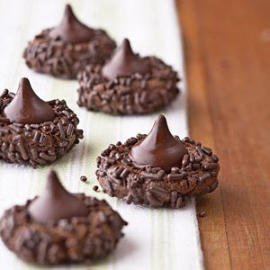 Call upon chocolate-loving kids to shape the cookie dough for these cocoa-flavored treats. For a more festive presentation, use red and green sprinkles instead of chocolate-flavor ones called for in the recipe.
