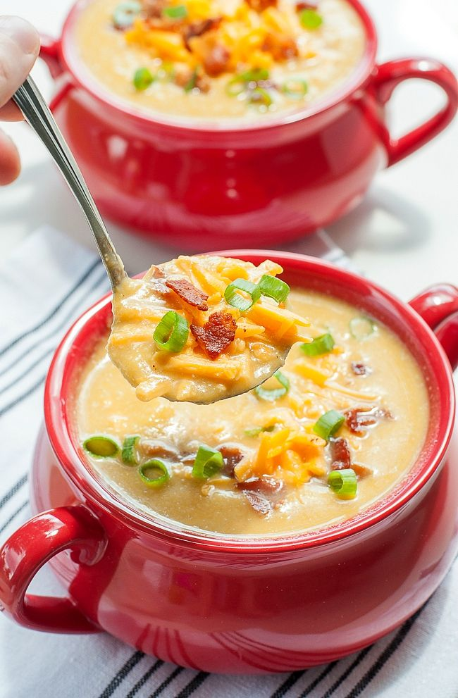 Creamy cauliflower soup like you've never had it before! This Slow Cooker Sweet Potato and Cauliflower Soup recipe is positively delicious and so easy to make