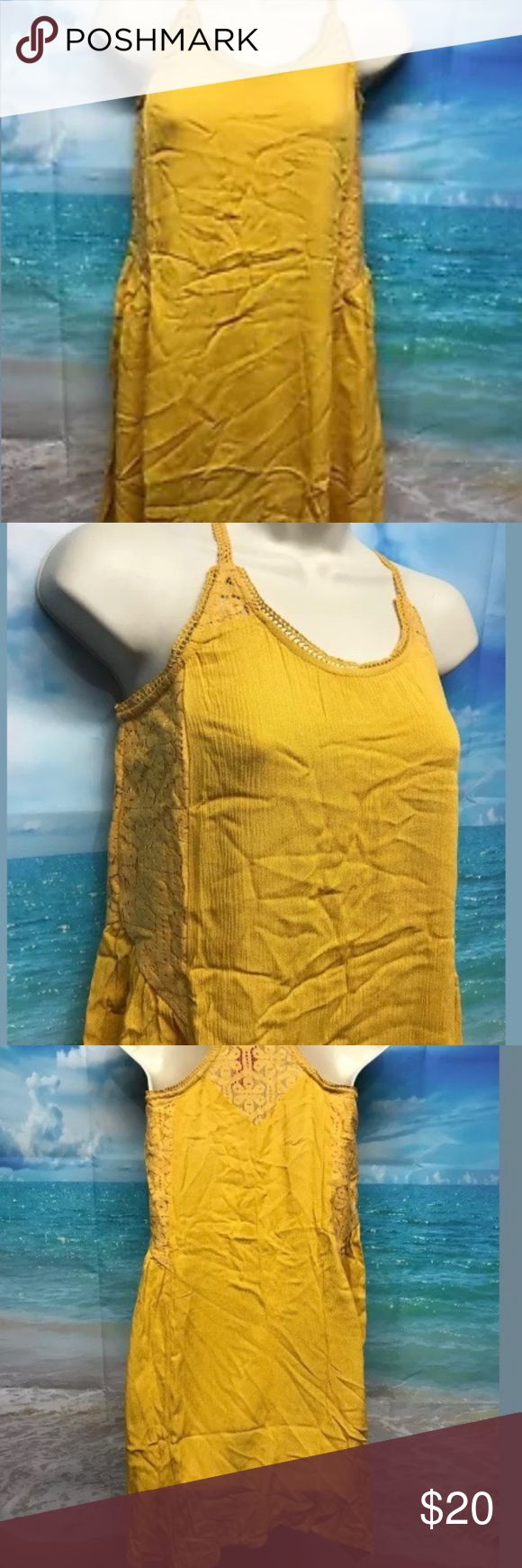 "Xhilaration Yellow Festival Dress M Spaghetti Boho Xhilaration Yellow Festival Dress M Spaghetti Boho Lace Asymmetrical NWT 982 Measurements Laying Flat:  Armpit to Armpit: 17"" Length: 35"" Waist: 19"" Hips: 27"" Xhilaration Dresses"