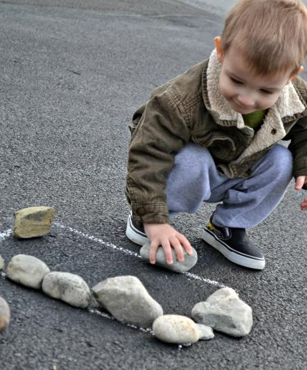 Making Rock Shapes.  Draw shape with chalk on pavement, then, using oversized rocks, have child place rocks on the line