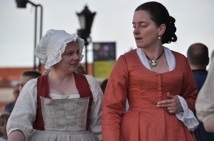 18th century townswoman Gdansk with the maid for a walk in the port