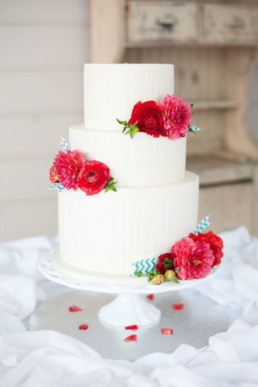 Breathe life into an uncomplicated white cake with bursts of color via bright flowers. It's an easy but oh-so-stylish way to upgrade your celebration....maybe with peonies