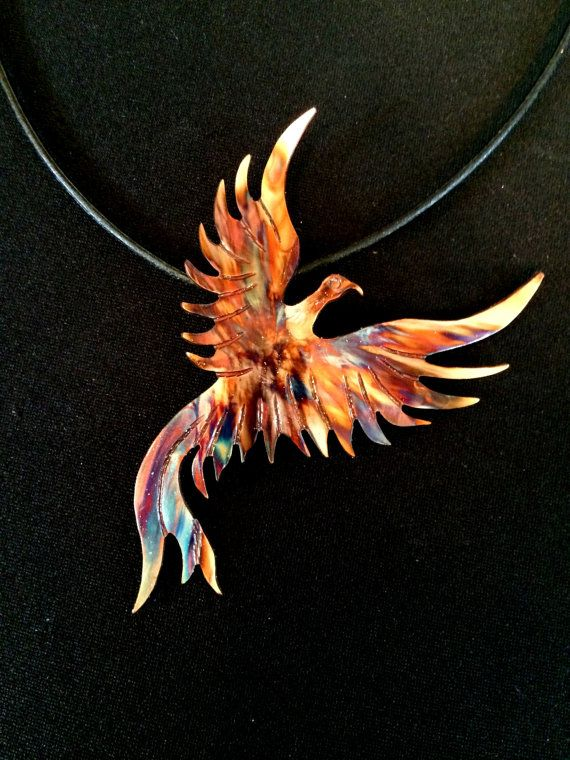 Out of the Ashes This statement piece is hand cut from copper sheet using a tiny serrated handheld jewelry saw and then tooled to depict a