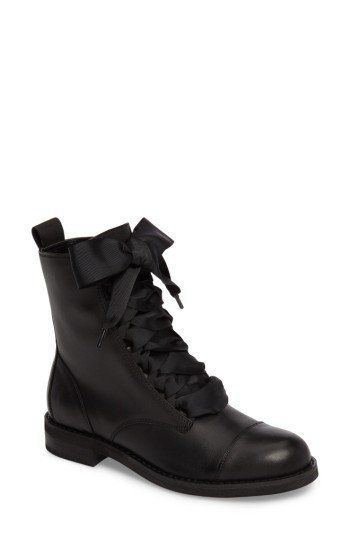 Delicate vintage flowers and grosgrain laces soften the tough-girl look of a cap-toe combat boot in glazed leather.