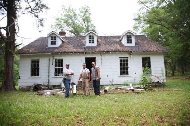 """National Geographic: Abandoned TV show. Dan, Jay and Mark standing outside of Owens Homestead. The saying goes, """"one man's junk is another man's treasure"""" and that is certainly the case for expert carpenter and collector Jay Chaikin. He makes a living scouring the nation for abandoned buildings that may hold unexpected """"gems"""" of history with shockingly high values. Follow Jay and his buddies Dan and Mark across the country on their ongoing quest to find their next big paycheck."""