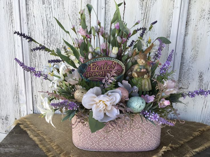 Easter greetings spring floral arrangement bunny and