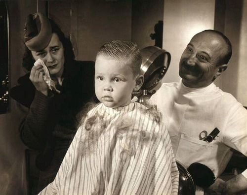young boy getting his haircut