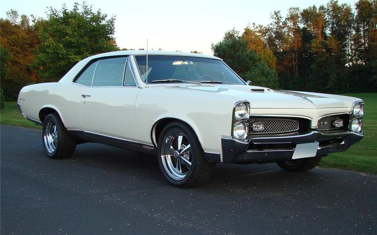 Classy Cameo Ivory with blue interior. Frame-off restoration with 348 miles since completion. Upgraded to a 455cid V8 with 4-speed manual transmission. PHS d...
