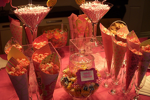 coloured popcorn in glasses.  Cheap and takes alot of table room