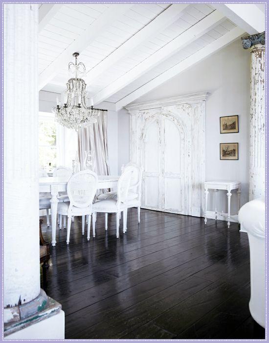 French Scandinavian White Dining - dark wood floor, white furniture, chandelier, architectural elements.