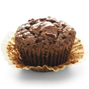 "Brownie Cupcakes Recipe -""I grew up in my parents' bakery, which might explain why I don't like frosting,"" says Cindy Lang of Hays, Kansas. ""These cupcakes are just my style! They come out shiny on top and are great without frosting."""